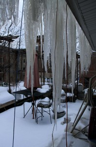 Icicles hang from eave on veranda level